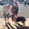 CHESLEY OXENDINE/Muskogee Phoenix<br /> Bill Tedrick of Fort Gibson donates a dollar to Dave, a performing dog, earning money for the Salvation Army outside Arrowhead Mall.