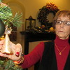 Staff photo by Cathy Spaulding<br /> Susan Thompson displays a delicate angel ornament she and her husband picked up on a European river cruise. More heirlooms can be seen during the Kelly B. Todd Christmas Home Tour.