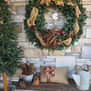 Staff photo by Cathy Spaulding<br /> A wreath, pinecones and a burlap gift greet visitors to the Jim and Susan Thompson home.