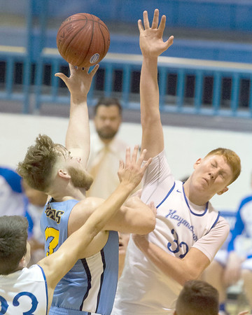 VON CASTOR/Special to the Phoenix<br /> Haskell's Brace Polk attempts to block the shot of Oktaha's Matthew Fry Tuesday night at Haskell. The Haymakers beat the Tigers 67-51.