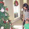 CATHY SPAULDING/Muskogee Phoenix<br /> Lauren Deatherage asks her son, Luke, to choose a favorite ornament on the family Christmas tree. Visitors can see favorites during the Christmas Homes Tours this weekend.