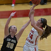 Phoenix special photo by Von Castor<br /> Fort Gibson's Kayci Glover shoots over an Inola defender Tuesday night in the Home opener at Harrison Field House.