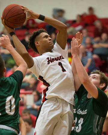 Phoenix special photo by Von Castor<br /> Hilldale's Devin Hembry shoots in the lane over Catoosa's Damon Phelps in Tuesday night's home opener at the Hilldale Event Center.