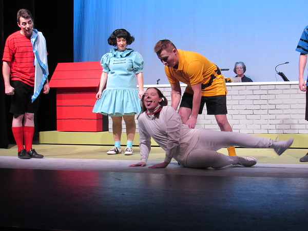 """CATHY SPAULDING/Muskogee Phoenix<br /> Charlie Brown (Chase Sinclair, right) plays with his beagle, Snoopy (Mallory Lindsay), while Linus (Seth Arnold, left) and Lucy (Meaghan McCawley) watch, during the Muskogee Little Theatre production """"You're a Good Man, Charlie Brown."""""""