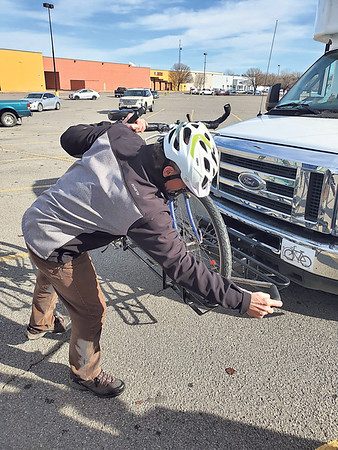 CHESLEY OXENDINE/Muskogee Phoenix<br /> Cyclist Doug Walton demonstrates how to use one of the new bike racks affixed to Muskogee County Transit buses.