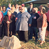 Staff photo by Mike Elswick<br /> Descendants of Willie and T.J. Elliott gather around a plaque placed at Elliott Park during re-dedication ceremonies Thursday. Willie Elliott donated the land for the park to the city in 1935 after her husband's death.