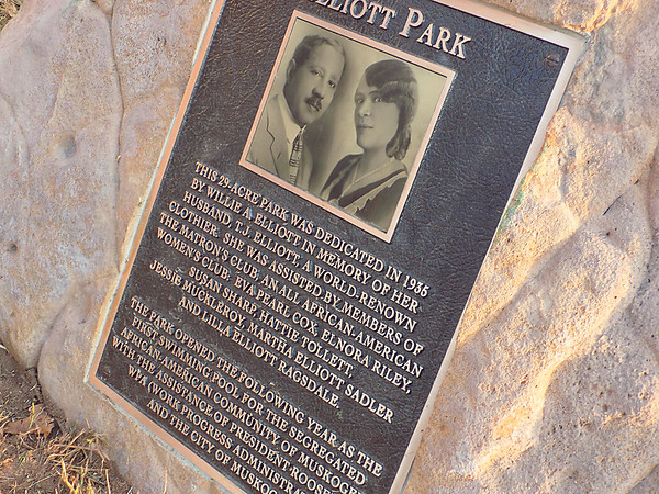 Staff photo by Mike Elswick<br /> A new plaque highlighting the history of Muskogee's Elliott Park was a focal point during Thursday's re-dedication ceremony for the park. The 29 acres for the park were donated by Willie A. Elliott in memory of her husband, T.J. Elliott, who operated a well-known clothing company in Muskogee for years. The park served as home to Muskogee's segregated swimming pool for many years.