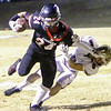 Phoenix special photo by John Hasler<br /> Keys' Alden Terrell breaks the tackle of Lincoln Christian's Adler Isbell in action Friday at Park Hill. Lincoln Christian won, 42-14.