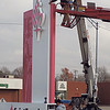 "Staff photo by Mike Elswick<br /> The main Okmulgee Avenue entrance to Saint Francis Hospital Muskogee had new signs installed Wednesday featuring a likeness of the hospital's namesake, Saint Francis, with a logo that includes a star and a stylized flame with the letters ""SFH,"" standing for Saint Francis Hospital. Helping with the installation from Claude Neon Federal Sign Co. of Tulsa were Andrew Wagnon, in bucket lift, and Raul Rangel on the ground. Project supervisor Russell Rice said the company will be involved for several days installing new signs across the Muskogee campus of Saint Francis Hospital. Saint Francis Health System of Tulsa acquired the former EASTAR hospital earlier this year."