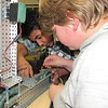 CATHY SPAULDING/Muskogee Phoenix<br /> Alice Robertson Junior High students Genesis Houston, left, and Hunter Hollingshed, work on the intricacies of their robot, which will compete in the VEX Robotics Turning Point competition at their school Dec. 8.