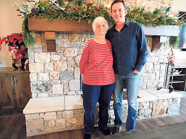 KENTON BROOKS/Muskogee Phoenix<br /> Jane Teel and her son Glen stand in front of the fireplace at Jane's home at 32051 E. 747 Road, in Wagoner. Jane Teel's home is one of the five homes that are part of the Wagoner Christmas Home Tour, scheduled for 1-5 p.m. Sunday. Jane Teel said the fireplace is her favorite part of the house.