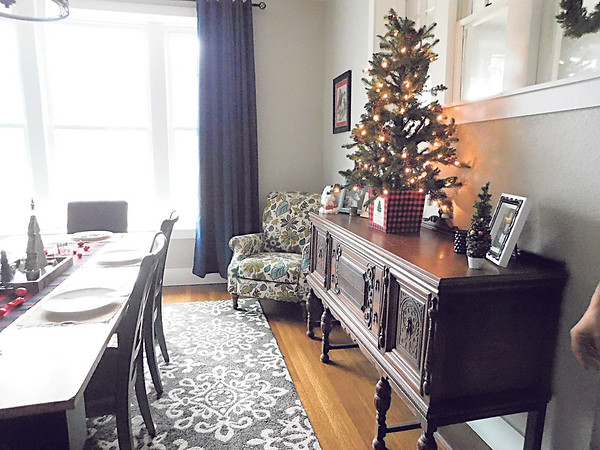 A Christmas tree atop a buffet gives the dining room of Adam and Jessica Colbert a festive touch. The Colberts' home, located at 601 N. State St., is one of the five homes that will be on the Wagoner Christmas Home Tour, scheduled for 1-5 p.m. Sunday. The house was built in 1910.