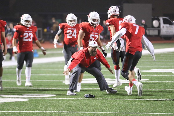 Phoenix special photo by John Hasler<br /> Fort Gibson coach Sammy Johnson celebrates with Chance Wofford after Wofford scored the Tigers' first touchdown. Fort Gibson lost 34-24.