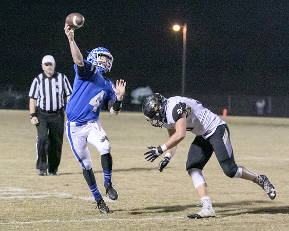 Phoenix special photo by Shane Keeter<br /> Checotah's Cade Shropshire escapes a Beggs rusher to throw a touchdown pass, Checotah's only touchdown of the game.