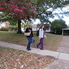 CATHY SPAULDING/Muskogee Phoenix<br /> Wanda Hudson, left, and Bonnie Hall pass colorful fall foliage and fallen leaves, as they walk along Honor Heights Drive on Monday afternoon, after working at Jack C. Montgomery VA Medical Center. Autumn leaves often hit their most colorful in early November.
