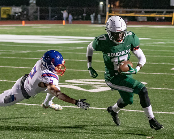 SHANE KEETER/Phoenix special photo<br /> Muskogee's Braylin Reed gets through an attempted tackle from Bixby's Jordan Reagan on Friday night at Indian Bowl.