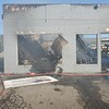 CHESLEY OXENDINE/Muskogee Phoenix<br /> What's left of D&J's Auto Clinic in Wagoner smolders after firefighters extinguished a blaze that destroyed the building on Tuesday.