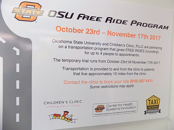 Staff photo by Mike Elswick<br /> Posters at the Children's Clinic of Muskogee provide details of a free ride program being tested for patients living within 10 miles of the facility.