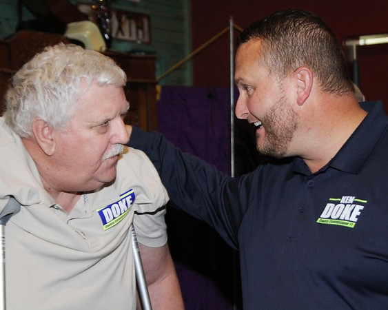 JOHN HASLER/Special to the Phoenix<br /> From left, Bob Burgess, a 30-year county employee, congratulates Ken Doke on his victory to retain his seat as District 1 Muskogee County commissioner.