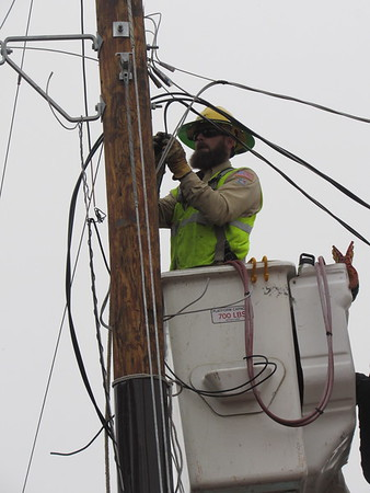 CATHY SPAULDING/Muskogee Phoenix<br /> An OG&E worker adjusts electric lines on a pole. A crew with OG&E worked on replacing a transformer pole near the Jack C. Montgomery VA Medical Center on Wednesday.
