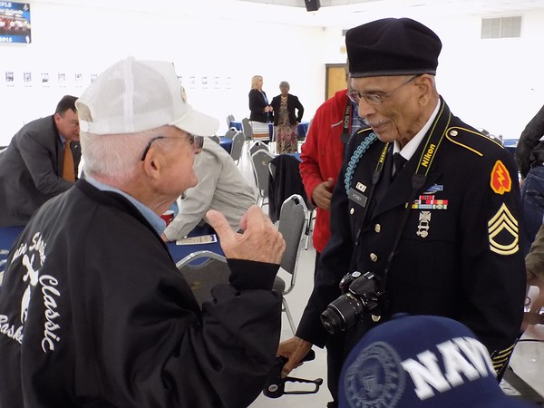 Staff photo by Mike Elswick<br /> Navy veteranStan Martin, left, visits with Army veteran Herman Kirby at Wednesday's banquet hosted by the Greater Muskogee Area Chamber of Commerce honoring area veterans.