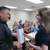 CATHY SPAULDING/Muskogee Phoenix<br /> Victor Lezama, creator of The Barracks, presents an iPad to Hilldale eighth-grader Kiarra Guerrero, who won a Veterans Day Essay Contest. Kiarra read her essay Thursday at a Veterans Appreciation event.