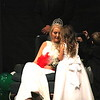 Staff photo by Harrison Grimwood<br /> Muskogee High School homecoming flower girl Addyson Lewis, 4, confers with her queen, Avery Clark, during the homecoming coronation.