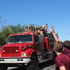 Staff photo by Cathy Spaulding<br /> Elementary students yell for Warner High cheerleaders to throw candy during a Friday parade.