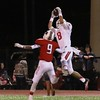Phoenix special photo by John Hasler<br /> Fort Gibson's Devin Murray intercepts pass intended<br /> for Poteau's Jameson Shackleford during the Tigers' 31-21 loss in a Dis- trict 4A-4 battle on Friday at Poteau.