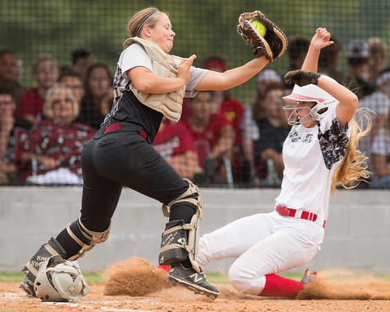 Phoenix special photo by Von Castor<br /> Wagoner catcher Peyton Stroud tries to apply the tag to a Locust Grove baserunner at home plate Wednesday in a Class 4A district playoff. Wagoner swept Locust Grove.