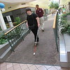 Staff photo by Cathy Spaulding<br /> Oklahoma School for the Blind senior Patelin Cogswell uses her white cane and sense of hearing to cross over a fountain at Arrowhead Mall. OSB orientation and mobility instructor Gina Woods follows.