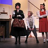 "Staff photo by Cathy Spaulding<br /> The Banks children (Tommy Woodburn, center, and Isabella Locke) size up their new nanny, Mary Poppins (Jessica Holloway) in a scene from the Muskogee Little Theatre production of ""Mary Poppins."""