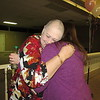 Staff photo by Cathy Spaulding<br /> Breast cancer patient Anna Campbell, left, embraces radiologic technologist Denise Roberts after modeling in the 11th annual Breast Cancer Awareness Event, held Thursday at Arrowhead Mall.