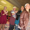Staff photo by Cathy Spaulding<br /> Breast cancer survivors and patients applaud after modeling in the 11th annual Breast Cancer Awareness Event, held Thursday at Arrowhead Mall.