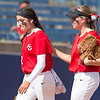 Phoenix special photo by Von Castor<br /> Fort Gibson's Maddi Jo Williams, right, con- soles Courtney Hill after the Lady Tigers' 1-0 loss to Tuttle in Friday's Class 4A state fastpitch semifinal game at ASA Hall of Fame Stadium in Oklahoma City.
