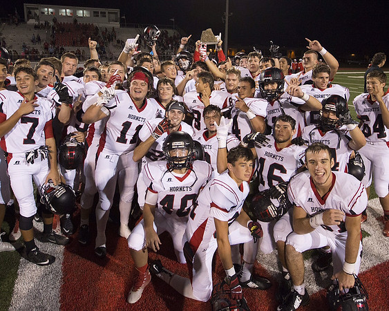Phoenix special photos by John Hasler<br /> Hilldale players gather around The Rock won at Fort Gibson last season. They'll seek to hold onto it in the annual rival battle on Friday.