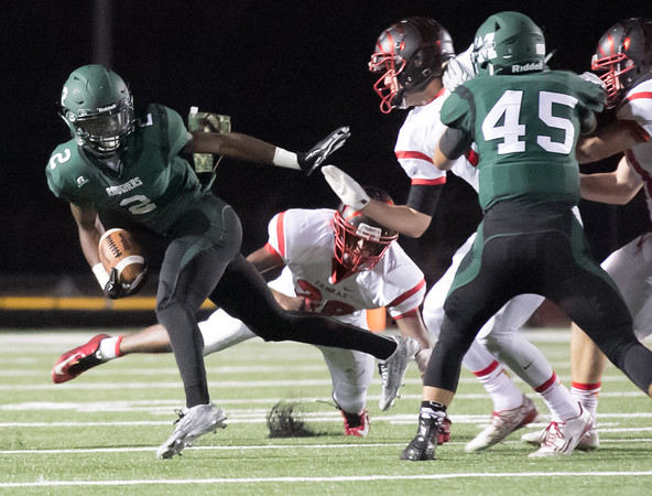 Phoenix special photo by Shane Keeter<br /> Muskogee's Kamren Curl, left, gets around the block of teammate Jeremiah Medrano for extra yardage on an<br /> interception return during last Friday's game against Claremore. Curl is fourth among area receivers with 470<br /> yards heading into Friday's game at Sand Springs.