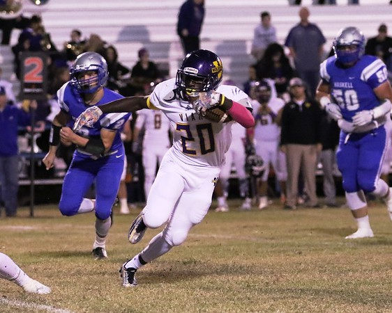 Phoenix special photo by John Hasler<br /> Vian Terron Moses breaks for a big gain in front of Haskell's David Norsworthy, left, and Ryan Lechner. Vian beat Haskell 38-0.
