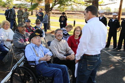 Staff photo by Harrison Grimwood U.S. Rep. Markwayne Mullin (R-Okla) speaks with Earl Ginn, a World War II veteran on the left, during a ceremony at the Muskogee War Memorial Park.