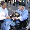 Staff photo by Harrison Grimwood<br /> U.S. Rep. Markwayne Mullin (R-Okla) presents Earl Ginn, a World War II veteran, with medals to replace Ginn's old, deteriorated collection during a Thursday ceremony at the Muskogee War Memorial Park.