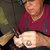 Staff photo by Cathy Spaulding<br /> Sammy Henry measures a diamond to be set. Henry has been a jeweler for nearly 34 years.