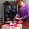 Special photos by Mike Elswick<br /> Women Who Care co-founder Wren Stratton looks over items recently donated to the organization by Economy Pharmacy. She said the items will be used as door prizes at future  meetings and fundraisers.