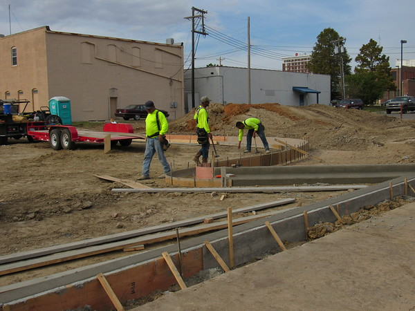 Staff photo by Cathy Spaulding<br /> Workers with Ross Construction, from left, Gumaro Ross, Leo Serrano and Chad Henry do frame work for curbing and guttering for new downtown Muskogee parking lot.