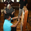 Special photos by Wendy Burton<br /> Cultural Interpreter John Timothy, left, and student Henry Medeiros move a loom that will be displayed at Ataloa Lodge Museum.