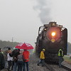 Staff photo by Cathy Spaulding<br /> Steam billows from the Living Legend No. 844 locomotive as onlookers watch its arrival Wednesday morning in Wagoner. The stop was part of a 1,200-mile tour.