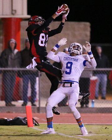 Phoenix special photo by Von Castor<br /> Hilldale's Grant Sikes, left, leaps high over Checotah's Drew Dan for a touchdown catch during last year's game at Hilldale. The two teams meet again Friday in Checotah and the Hornets can clinch first place in District 3A-6 with a win.