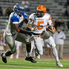Phoenix special photo by Von Castor<br /> Tahlequah's Cayden Aldridge tries to break the tackle of Tulsa Memorial's Isaiah Thomas Thursday night at LaFortune Stadium in Tulsa.