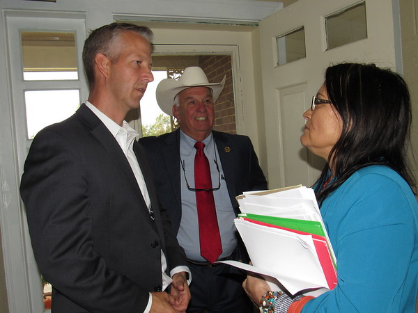 Staff photo by Cathy Spaulding<br /> AT&T Oklahoma State President Steve Hahn, left, and State Rep. Jerry McPeak, visit with Murrow Indian Children's Home Executive Director Betty Martin during a visit to the home. AT&T presented $50,000 for the home's transition program.