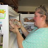 Staff photo by Cathy Spaulding<br /> Yavonna Bolding stores a ham in her freezer. She is helping the group Replenishing Oklahoma collect Thanksgiving food and staples for five families.