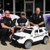 "Staff photo by Harrison Grimwood<br /> Muskogee police officers received their latest patrol vehicle Friday afternoon, a toy car with ""Muskogee Police"" decals. Big Toys Green Country, a company the specializes in children's vehicles, rolled the car out for the law enforcers as a gift.<br /> Now, the department is set to give the vehicle away through a contest aimed at Muskogee's youngest, ages 1 to 4, Muskogee Deputy Police Chief Chad Farmer said.<br /> Children can draw or color in law enforcement-related images for a chance to win the vehicle, Farmer said. Muskogee Police Officer Lincoln Anderson, spokesman for the department, said parents and siblings are barred from helping. However, parents or guardians can drop their children's entries off at the Muskogee Police Department, 112 S. Third St., or Big Toys Green Country, 808 Callahan St., to enter the contest. Entrants wishing to drop their entry off at Big Toys are encouraged to do so during business hours.<br /> Anderson said entries should include a name and phone number so the contest winner can be contacted. The deadline for submissions is 3 p.m. Nov. 4."